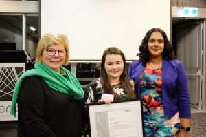 Genevieve Mooney (centre) accepts her award